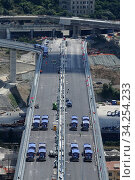 Купить «View of trucks driving over the new Genoa Bridge as part of a static test to examine the robustness of the structure ,Genoa,ITALY-19-07-2020.», фото № 34254233, снято 19 июля 2020 г. (c) age Fotostock / Фотобанк Лори