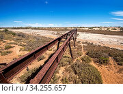 Купить «Australia – Old Ghan railway bridge over a dried-out river bed at the outback desert under blue sky», фото № 34255657, снято 7 августа 2020 г. (c) easy Fotostock / Фотобанк Лори