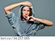 Torso Portrait of the beautiful sexy woman in grey hoody blouse. Стоковое фото, фотограф Zoonar.com/© Dmitry Raikin / easy Fotostock / Фотобанк Лори