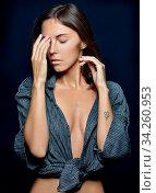 Torso portrait of the beautifl woman in a shirt in studio. Стоковое фото, фотограф Zoonar.com/© Dmitry Raikin / easy Fotostock / Фотобанк Лори