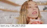 Beautiful woman drinking coffee at home. Стоковое видео, агентство Wavebreak Media / Фотобанк Лори