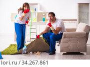 Купить «Young pair doing housework at home», фото № 34267861, снято 11 декабря 2019 г. (c) Elnur / Фотобанк Лори