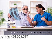 Two male doctors working in the clinic. Стоковое фото, фотограф Elnur / Фотобанк Лори