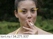 Woman smokes. Photo by André Maslennikov (2007 год). Редакционное фото, фотограф Andre Maslennikov / age Fotostock / Фотобанк Лори