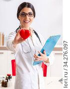 Young doctor in heart care concept. Стоковое фото, фотограф Elnur / Фотобанк Лори