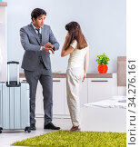 Wife seeing her husband off to business trip. Стоковое фото, фотограф Elnur / Фотобанк Лори