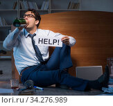 Employee asking for help and drinking under stress and despair. Стоковое фото, фотограф Elnur / Фотобанк Лори
