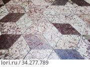 Купить «Old floor tiling with abstract cubic pattern», фото № 34277789, снято 8 марта 2020 г. (c) EugeneSergeev / Фотобанк Лори