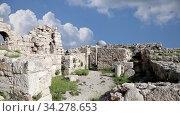 Amman city landmarks-- old roman Citadel Hill against the background of moving clouds, Jordan. Стоковое видео, видеограф Владимир Журавлев / Фотобанк Лори