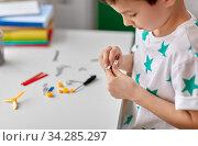 Купить «happy little boy playing with airplane toy at home», фото № 34285297, снято 19 апреля 2018 г. (c) Syda Productions / Фотобанк Лори