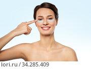 Купить «beautiful young woman with under-eye patches», фото № 34285409, снято 30 ноября 2019 г. (c) Syda Productions / Фотобанк Лори