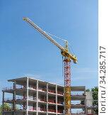 building crane on construction site. Стоковое фото, фотограф Syda Productions / Фотобанк Лори