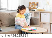 little girl drawing with coloring pencils at home. Стоковое фото, фотограф Syda Productions / Фотобанк Лори