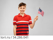 portrait of happy smiling boy in red polo t-shirt. Стоковое фото, фотограф Syda Productions / Фотобанк Лори