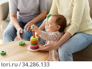 mother, baby daughter and granny playing at home. Стоковое фото, фотограф Syda Productions / Фотобанк Лори