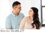 happy couple looking at each other at home. Стоковое фото, фотограф Syda Productions / Фотобанк Лори