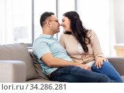 happy couple at home. Стоковое фото, фотограф Syda Productions / Фотобанк Лори