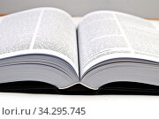 Opened big hefty book on the table. Стоковое фото, фотограф Jacek Tarczynski / easy Fotostock / Фотобанк Лори