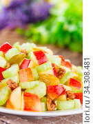 Купить «Fresh Waldorf salad made of celery, apple, walnuts, sultanas and raisins on plate (Selective Focus, Focus one third into the salad)», фото № 34308481, снято 5 августа 2020 г. (c) easy Fotostock / Фотобанк Лори