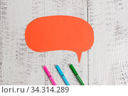 Ballpoints blank colored speech bubble wooden rustic vintage background. Стоковое фото, фотограф Zoonar.com/Artur Szczybylo / easy Fotostock / Фотобанк Лори