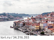 View of the historic town centre of Porto with the Rio Duoro River  from Dom Luis I bridge, Porto, Portugal. Редакционное фото, фотограф Николай Коржов / Фотобанк Лори