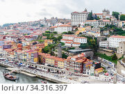 View of the historic town centre of Porto with the Rio Duoro River  from Dom Luis I bridge, Porto, Portugal. Редакционное фото, фотограф Николай Коржов / Фотобанк Лори