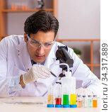 Young handsome biochemist working in the lab. Стоковое фото, фотограф Elnur / Фотобанк Лори