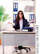 Купить «Young businesswoman sitting in the office», фото № 34319481, снято 5 августа 2020 г. (c) easy Fotostock / Фотобанк Лори