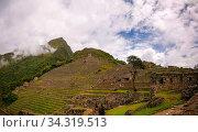 Panoramic view to Machu Picchu archaeological site with Polygonal masonry in Cuzco, Peru. Стоковое фото, фотограф Zoonar.com/Sergey Mayorov / easy Fotostock / Фотобанк Лори
