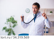 Young male handsome doctor working in the clinic. Стоковое фото, фотограф Elnur / Фотобанк Лори