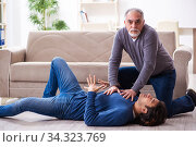 Grandfather and grandson in first aid concept. Стоковое фото, фотограф Elnur / Фотобанк Лори