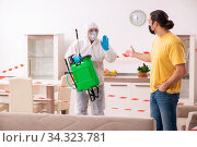 Sanitizer and young man indoors in disinfection concept. Стоковое фото, фотограф Elnur / Фотобанк Лори