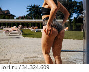 Woman with slim body having a shower, back view. Стоковое фото, фотограф Tryapitsyn Sergiy / Фотобанк Лори