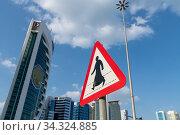 Doha, Qatar - Nov 21. 2019. The Crosswalk sign on West Bay background. Редакционное фото, фотограф Володина Ольга / Фотобанк Лори