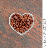 Kaffeebohnen in einer weißen Schale für die Food Fotografie Coffee beans in a white bowl for food photography. Стоковое фото, фотограф Zoonar.com/Volker Schlichting / easy Fotostock / Фотобанк Лори