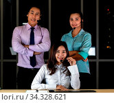 Late Night Environment, Potrait of friendly Call centre operator team with headsets in a call center customer service and technical support. Using for 24 Hr. Call center Concept. Стоковое фото, фотограф Zoonar.com/Vichie81 / easy Fotostock / Фотобанк Лори