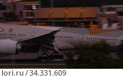 Купить «Airliner landing at the airport», видеоролик № 34331609, снято 26 ноября 2019 г. (c) Игорь Жоров / Фотобанк Лори