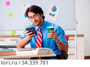 Купить «Young male financial manager working in the office», фото № 34339781, снято 5 августа 2020 г. (c) easy Fotostock / Фотобанк Лори