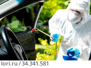 Close up of chemical alcohol spray cleaning inside car to disinfect... Стоковое фото, фотограф Zoonar.com/Vichie81 / easy Fotostock / Фотобанк Лори