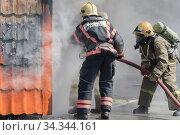 Купить «Firefighters extinguishing fire from fire hose, using firefighting water-foam barrel with air-mechanical foam», фото № 34344161, снято 27 апреля 2019 г. (c) А. А. Пирагис / Фотобанк Лори