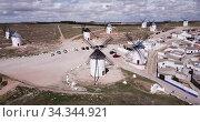 Scenic view from drone of ancient windmills in Spanish municipality of Campo de Criptana. Стоковое видео, видеограф Яков Филимонов / Фотобанк Лори