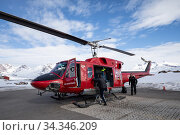 Air Greenland helicopter used for Kulusuk to Tasiilaq flights. East Greenland. April 2018. Редакционное фото, фотограф Franco  Banfi / Nature Picture Library / Фотобанк Лори
