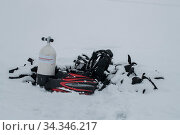 Diving gear under fallen snow belonging to divers who have waited for the spring melt to explore the waters around an iceberg. Tasiilaq, East Greenland. April 2018. Стоковое фото, фотограф Franco  Banfi / Nature Picture Library / Фотобанк Лори
