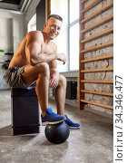 happy smiling young man with medicine ball in gym. Стоковое фото, фотограф Syda Productions / Фотобанк Лори