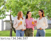 young women with non alcoholic drinks talking. Стоковое фото, фотограф Syda Productions / Фотобанк Лори