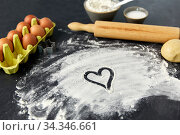 heart on flour, rolling pin, eggs and dough. Стоковое фото, фотограф Syda Productions / Фотобанк Лори