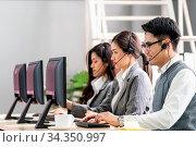 Купить «Young adult friendly and confidence operator asian man agent with...», фото № 34350997, снято 4 августа 2020 г. (c) easy Fotostock / Фотобанк Лори