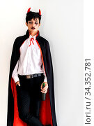 Portrait of asian young adult teenage man wear Halloween costume cloth... Стоковое фото, фотограф Zoonar.com/Vichie81 / easy Fotostock / Фотобанк Лори