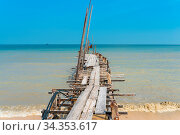 Ramshackle wooden jetty leads to the sea at the fishing village Teluk... Стоковое фото, фотограф Zoonar.com/Stefan Laws / easy Fotostock / Фотобанк Лори