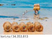 Traditional malagasy bamboo woven crustacean fishing trap on beach... Стоковое фото, фотограф Zoonar.com/Artush Foto / easy Fotostock / Фотобанк Лори